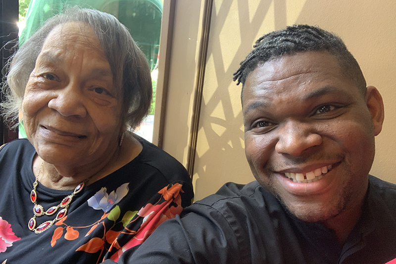 Darrell Goodwin smiles in a selfie with his grandmother