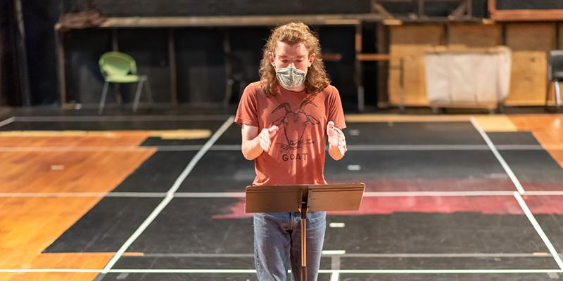 Owen Webster '22 debates at a podium