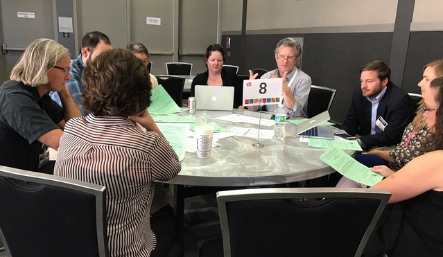 Tarrant Institute associate director John Downes EdD '16 (center) leads a roundtable discussion at AMLE's national conference. Photo credit: Katy Farber.