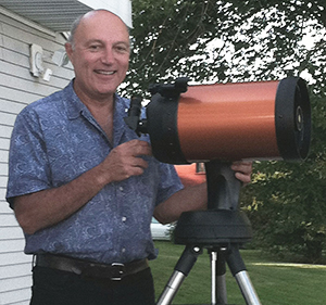 George Osol with his Celestron telescope