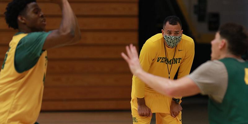Coach Hamlet Tibbs oversees men's basketball practice