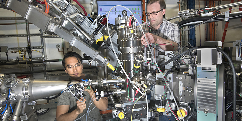 Two scientists work with high-tech equipment
