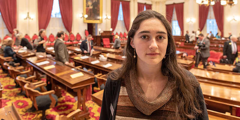 Lucy Rogers with Vermont State House floor in background.