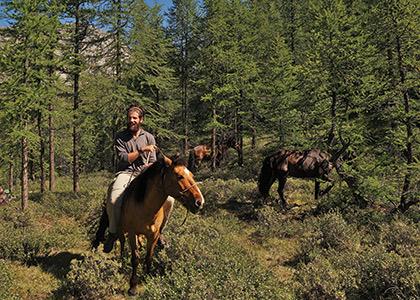 Simon McIntosh riding horses in Mongolia