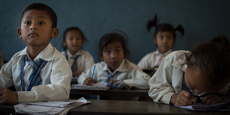 Elementary-aged students in a classroom in Nepal