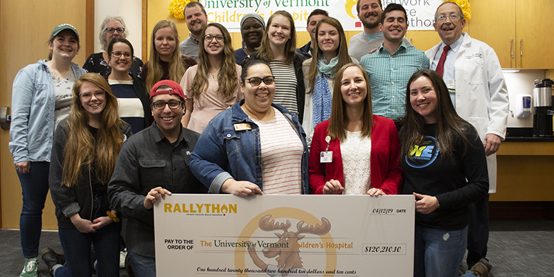 Students present a fundraising check to UVM Children's Hospital staff