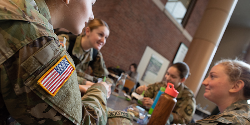 Four ROTC students sit around a table in UVM's Davis Center
