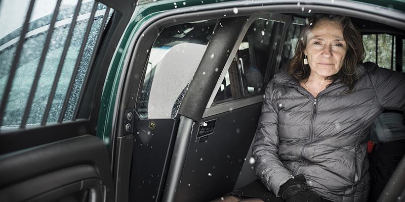 Study co-author Stephanie Seguino in police car.