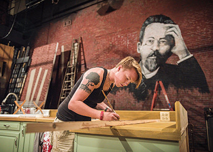 UVM student Jesse Cannon designing and building the set for the UVM theater production Stupid F*#king Bird