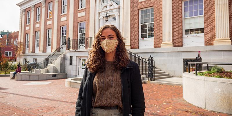 UVM senior Valentina Czochanski in front of Burlington City Hall