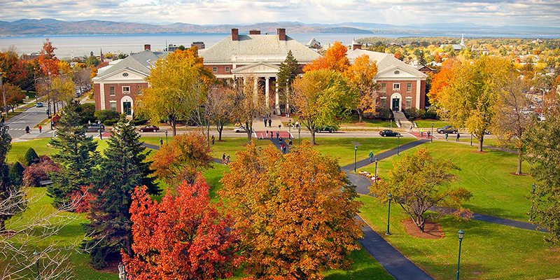 view of Waterman building, fall trees and Lake Champlain in the distance
