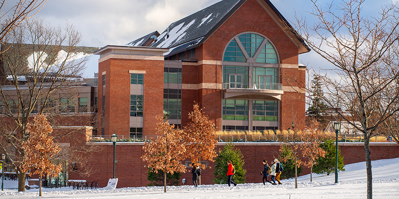 UVM in winter with snow covered Davis Center green