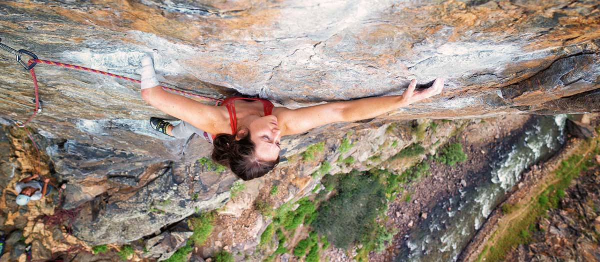 Mo Beck climbs a rock wall in the film