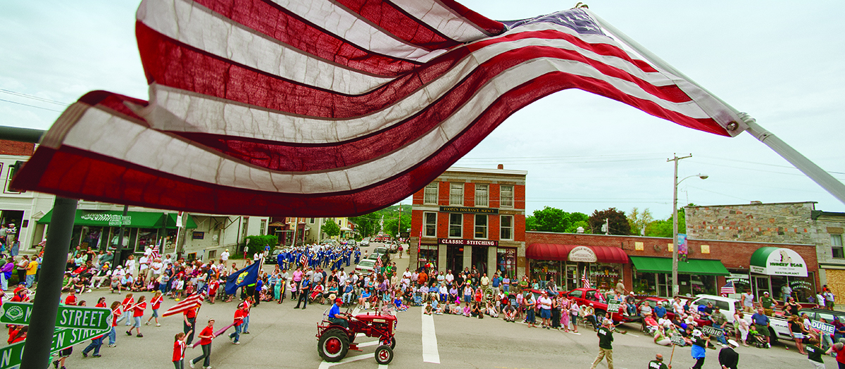 American flag waves in a Vermont street parade