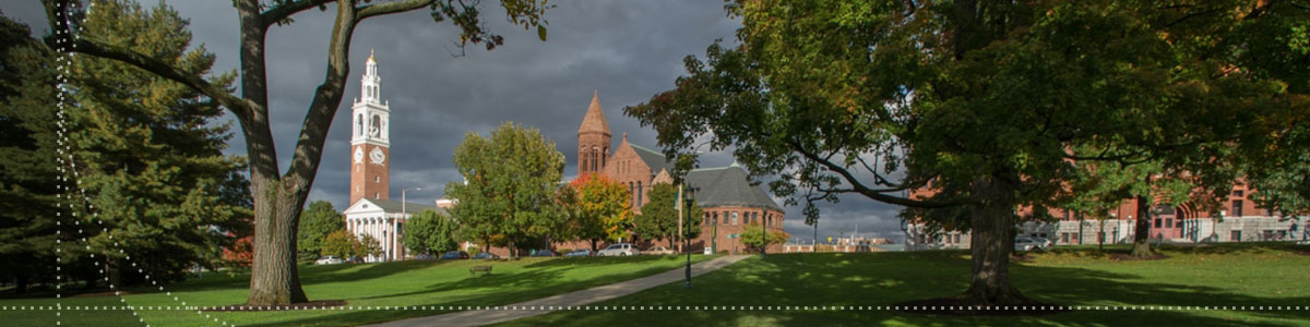 Photo of UVM campus green and the Ira Allen Chapel in the background