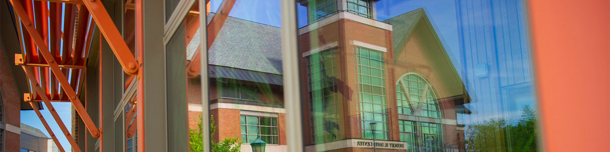 Reflection of the Davis Center in the Rubenstein Building