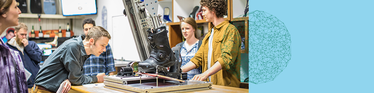 senior engineering students and faculty at Burton snowboards examining boot tester design