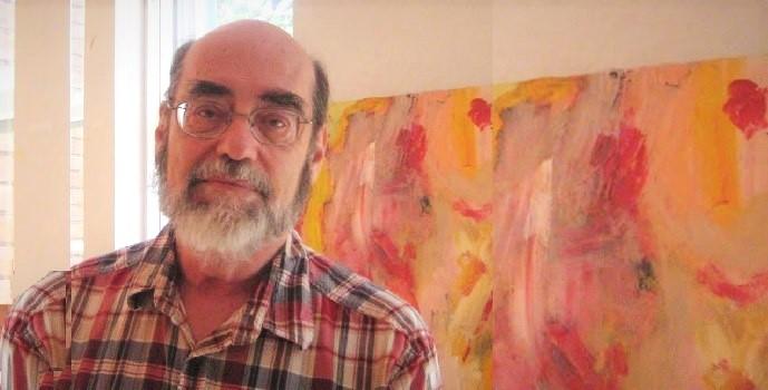 Thomas Simone looking at the camera, greying beard, wearing glasses