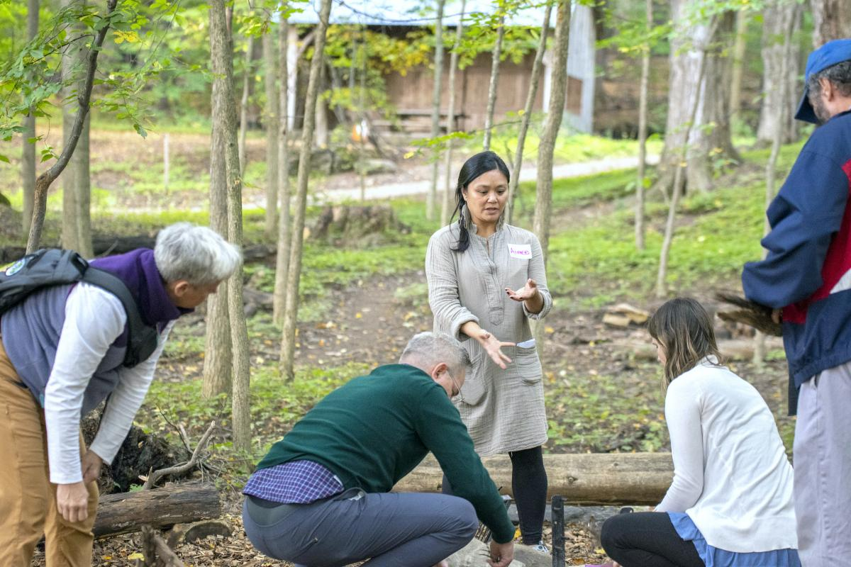 Aimee Arandia Østensen, a professional learning facilitator, speaks to participants at the UVM John Dewey Conference's experiential learning workshop at Shelburne Farms.