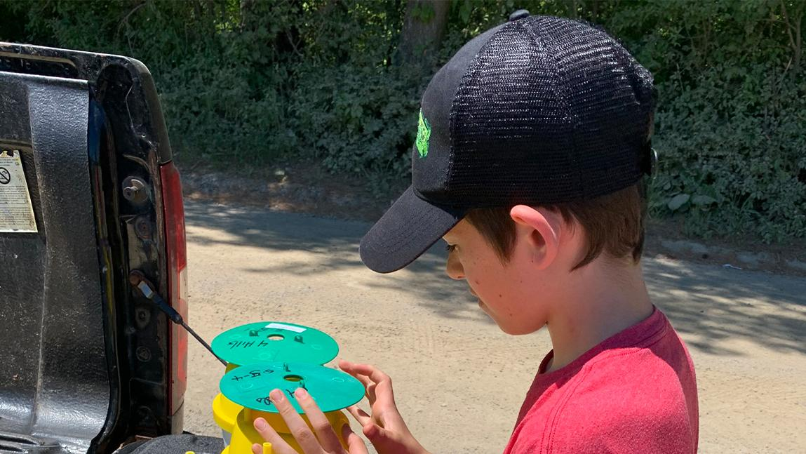 boy learning about integrated pest management traps