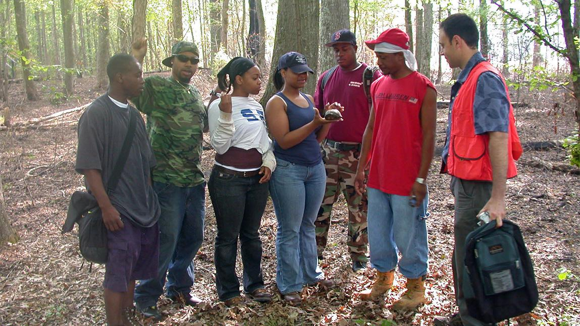 Group of Alabama Agricultural and Mechanical University students and instructor in the forest
