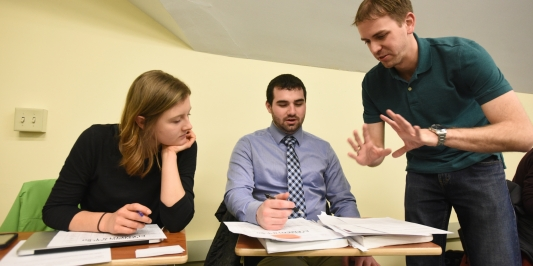 Graduate students working in a classroom