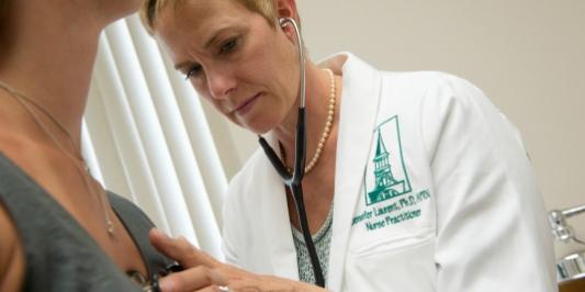Jennifer Laurent, assistant professor of nursing, in the clinic.