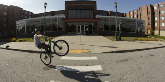 biking in front of Harris/Millis
