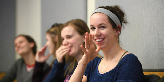ASL students enjoy a funny moment in class.