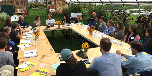 Tourism and extension specialists have meeting at greenhouse business