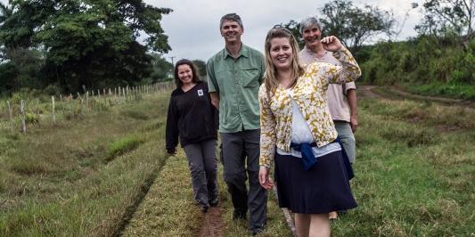 Gund Fellows walking a field