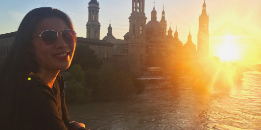Student at sunset in front of cathedral