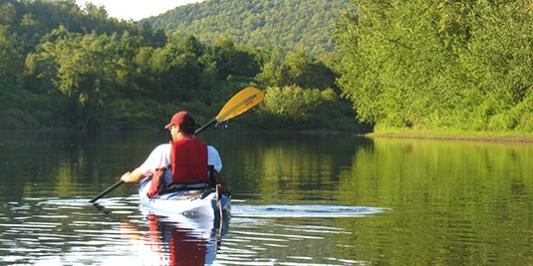 Man paddling on river