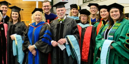 Doctoral students and faculty gather before Commencement