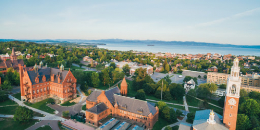 UVM's main campus with the lake in the background taken from a drone.