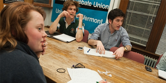 debate students gathered around a table at the Lawrence debate union