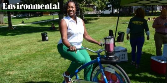 Employee riding smoothie bike.