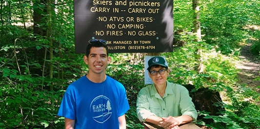 Student intern with Williston VT conservation commission member in woods