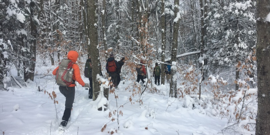 students hiking in the snow