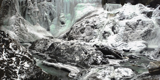 Icy river and waterfalls