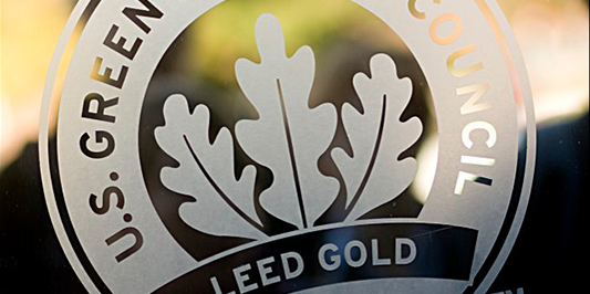 a close up shot of a leed gold certification decal on a window
