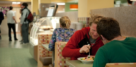 students eating in Redstone Unlimited dining hall