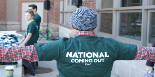 green tshirt with white lettering that says National Coming Out Day