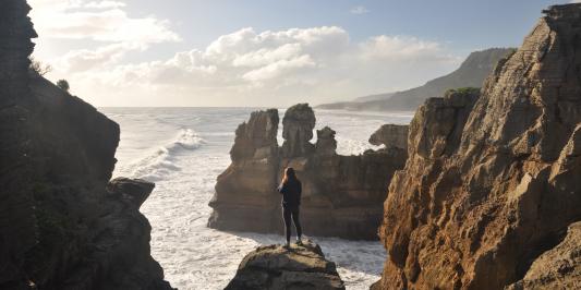 Student on top of the Pancake Rocks in Punakaiki, New Zealand