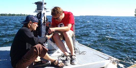 Graduate students conduct research on lake