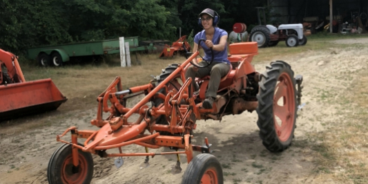 UVM Catamount Farm Student Driving Tractor