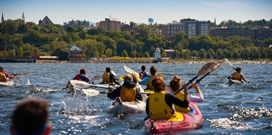 students kayaking on lake champlain