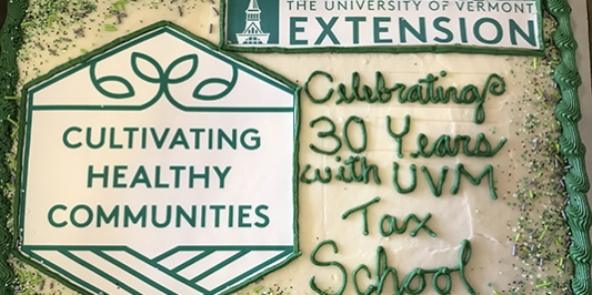 green and white anniversary cake celebrating 30 years with UVM tax school