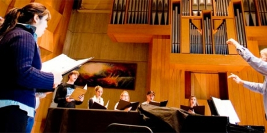 A rehearsal in UVM's recital hall