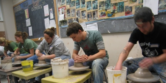 Students using pottery wheels